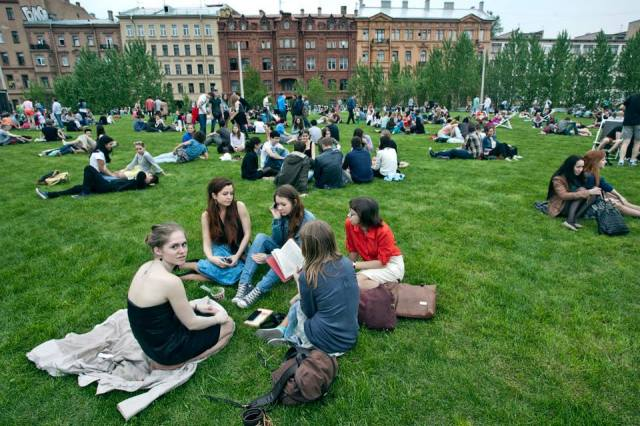 Festival-goers enjoy New Holland's lawn. Photo by Egor Rogalev, courtesy of New Holland.