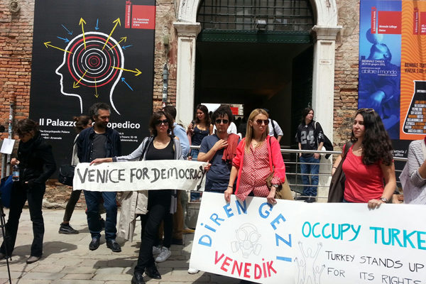 Protests outside the Arsenale, as captured by curator Defne Ayas